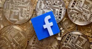 A 3-D printed Facebook logo is seen on representations of the Bitcoin virtual currency in this illustration picture. Image: Dado Ruvic / Reuters.