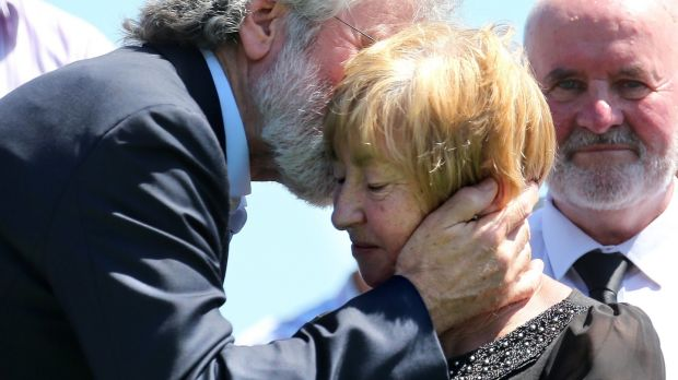 Gerry Adams with widowed Marcella McKenna at the funeral Kevin McKenna at St Mary's Chapel. Photograph: Crispin Rodwell/The Irish Times