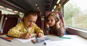 Making the most of the journey: families can enjoy the extra leisure time train travel provides. Photograph: Getty Images