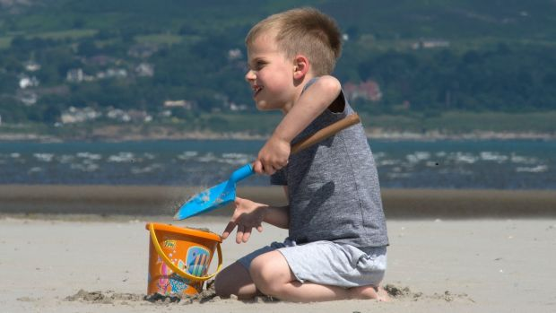 Dylan Dinnyes (five) playing on Dollymount Strand in Dublin on Thursday. Photograph: Dave Meehan/The Irish Times.