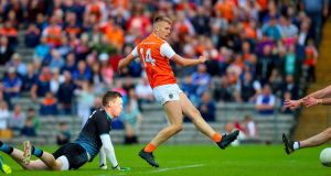 Rian O'Neill scores a goal for Armagh in the victory over Monaghan at Clones. Photograph: Tommy Dickson/Inpho