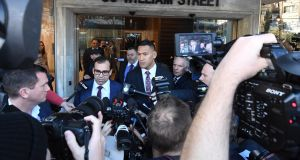 Israel Folau (C) leaves a conciliation hearing at the Fair Work Commission in Sydney, New South Wales. Photo: Peter Rae/EPA