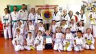 Greville Stockil (right of centre at back) with his class after a recent presentation of colour belt promotion certificates in Thurles, Co Tipperary.