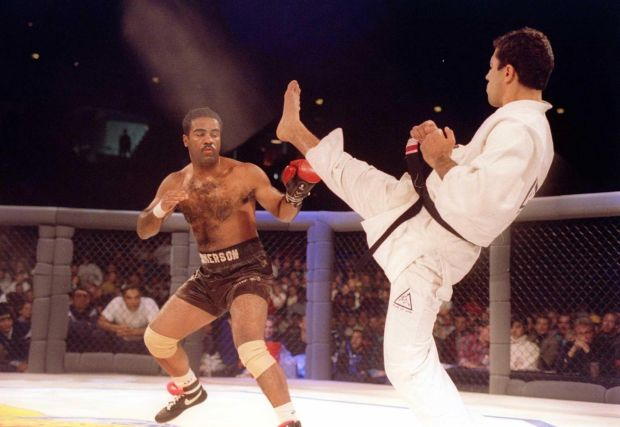 Jiujitsu black belt Royce Gracie kicks at cruiserweight boxer Art Jimmerson during a 1st round match in the Ultimate Fighter Championships in Denver, Colorado. Gracie went on to win the match and eventually the championship. Photograph: Markus Boes