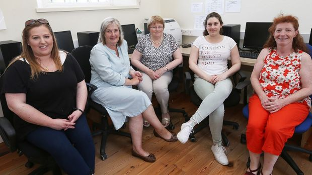Valerie Carty, Breda Malone, Eileen Murphy, Dohanna Delta and Sylvia Lyons pictured in the old school in Ballon that will be used as an alternative office for commuters. Photograph: Laura Hutton/The Irish Times