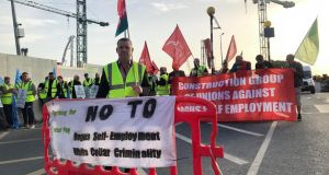 "Construction workers picketing the new national children's hospital on Friday as part of a protest over alleged ""bogus work practices""  on the site."