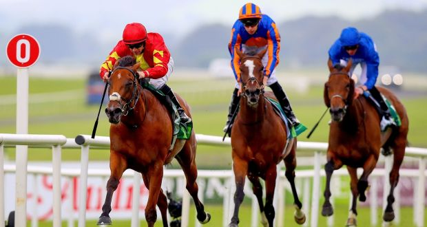 Jockey Wayne Lordan on Iridessa (left)  win the Juddmonte Pretty Polly Stakes at the Curragh. Photograph: Tommy Dickson/Inpho