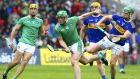 Tipperary's Noel McGrath tackling Limerick's Shane Dowling in the Munster  hurling championship at Semple Stadium on June 16th. Photograph: Ken Sutton/Inpho