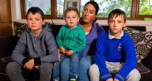 Michelle O'Brien with Tommy, Jamie and Joey, three of her seven children. She is a qualified beautician but has been unable to work due to the family's insecure housing situation. Photograph: Tom O'Hanlon