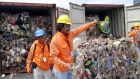 Philippines customs officials inspect cargo containers containing tonnes of garbage which had been shipped from Canada to  Manila port, in November  2014. File photograph: Handout/Reuters