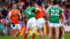 Mayo's Conor Loftus and Aidan Forker of Armagh get involved at half-time during the All-Ireland SFC round-three qualifier at Elverys MacHale Park in Castlebar. Photograph: James Crombie/Inpho