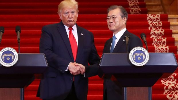 US president Donald Trump shakes hands with South Korean president Moon Jae-in during a joint press conference in Seoul. Photograph: Chung Sung-jun/AFP/Getty Images