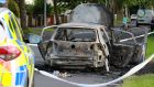 A burnt out car, thought to be a getaway vehicle, is seen at Huntstown Wood near the scene of a shooting in Castlecurragh Heath,  Mulhuddart. Photograph by Crispin Rodwell/The Irish Times.