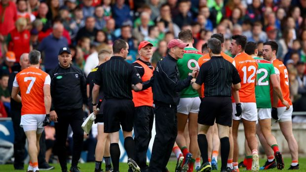 McGeeney speaks to referee Maurice Deegan at half-time. Photo: James Crombie/Inpho
