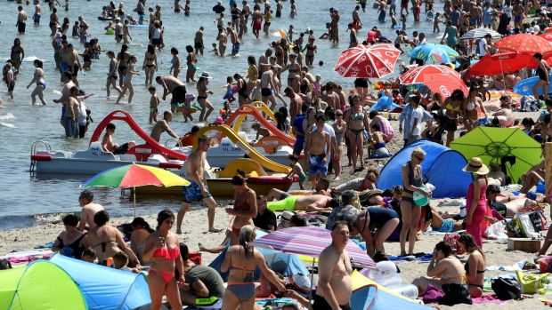 People sunbath by the Baltic Sea at Timmendorfer Strand, Germany. Photograph: Fabian Bimmer/Reuters