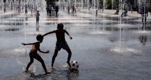 Children play at a fountain in Nice, southern France, on Sunday. Temperatures in Nice reached up to 33 degrees Celsius.  Photograph: Sebastien Nogier/EPA