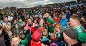 Mayo fans celebrate with Aidan O'Shea following the victory over Armagh in the qualifer clash at  Elverys MacHale Park, Castlebar. Photograph: James Crombie/Inpho