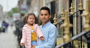 Maruf Ahmed with his daughter, Joanna (2), on Gardiner Street.  Photograph: Alan Betson / The Irish Times