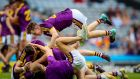CHAMPIONS: Wexford's Liam Cassin celebrates at the final whistle with his teammates following their victory over Kilkenny in the Leinster Minor Hurling Championship Final in Croke Park on Sunday. Photograph: Tommy Dickson/Inpho