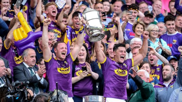 Wexford's Matthew O'Hanlon and Lee Chin lift the trophy. Photograph: Gary Carr/Inpho