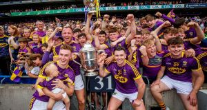 Wexford senior and minor players celebrate winning the Leinster titles at Croke Park. Photo: Ryan Byrne/Inpho