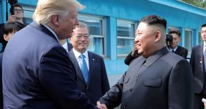 Donald Trump shakes hands with  Kim Jong-un as they meet at the demilitarized zone (DMZ) separating the two Koreas, in Panmunjom, South Korea on July 30th. Photograph: Reuters