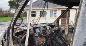 A burnt out vans  in the yard of the house which was the scene of an eviction in Strokestown, Co Roscommon last December. Photograph: Peter Murtagh