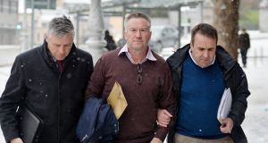 Former solicitor Michael Lynn (centre) is escorted into court in Dublin after arriving back in Ireland from Brazil last year. Photograph: Alan Betson