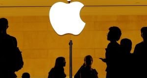 Customers walk past an Apple logo inside of an Apple store at Grand Central Station in New York. Photograph: REUTERS/Lucas Jackson/File Photo
