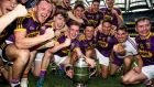 Wexford players celebrate securing the Leinster championship for the first time in 15 years. Photograph: Gary Carr/Inpho
