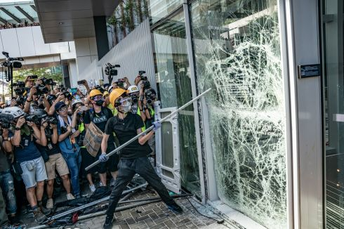 CRISIS CONTINUES: Protesters against a Bill which would allow extradition to China smash glass doors and windows at the Legislative Council complex in Hong Kong. Some protesters managed to enter the legislature and vandalise it, while thousands more gathered to march in opposition to the city's China-backed government on the 22nd anniversary of Hong Kong's return to Chinese rule. Photograph: Anthony Kwan/Getty Images