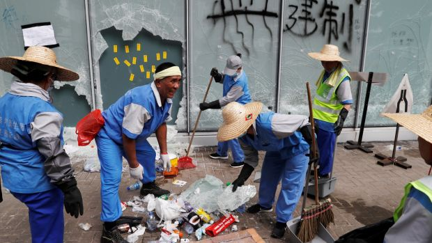 Workers clean up outside the Legislative Council, a day after protesters broke into the building in Hong Kong. Photograph: Jorge Silva/Reuters