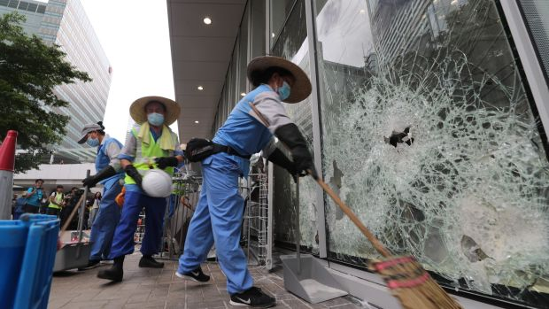 Cleaners clear remaining items and broken glass around the Legislative Council Building on Tuesday. Photograph: Ritchie B Tongo/EPA