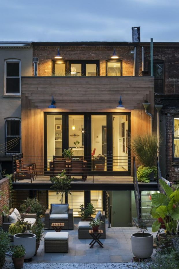 This Crown Heights brownstone in Brooklyn, New York, features cool industrial style lighting on its terrace and balconies above