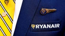 Ryanair logo is pictured on the the jacket of a cabin crew member. File Photograph: Francois Lenoir/Reuters