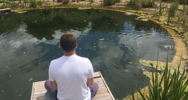 Darragh Murphy meditates at Vajrasana Retreat Centre in Suffolk, England.