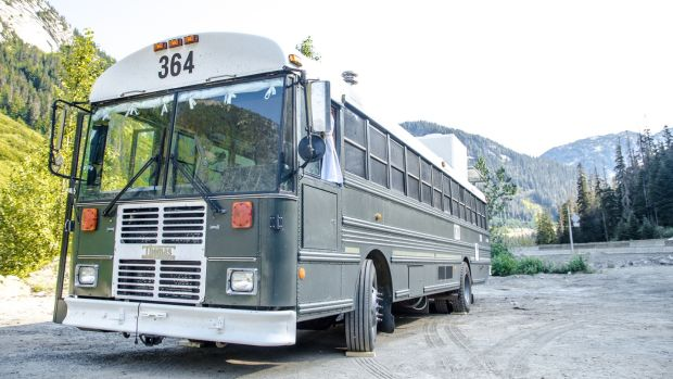 Canadian company Paved to Pines converts old buses into camper vehicles