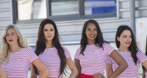 'Grid girls' pose during the Dutch MotoGP qualifiers in June 2019 in Assen. Photograph:  Mirco Lazzari gp/Getty Images