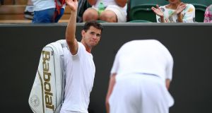 Dominic Thiem of Austria waves to the crowd as he leaves the court after loosing to Sam Querrey. Photograph: Getty Images