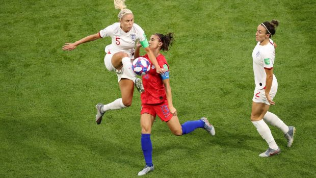 Steph Houghton tackles Alex Morgan. Photo: Lucy Nicholson/Reuters