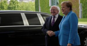 German chancellor Angela Merkel welcomes President Michael D Higgins for meeting at the chancellery in Berlin on Wednesday. Photograph: Markus Schreiber/AP