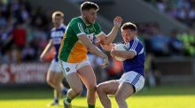 Laois's Ross Munnelly and Cian Donohoe of Offaly in their  round three championship qualifiers at  Portlaoise. Photograph:  Laszlo Geczo/Inpho