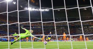 Jackie Groenen of the Netherlands scores her team's winner against Sweden. Photograph: Richard Heathcote/Getty Images