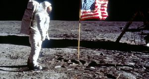 Astronaut Edwin 'Buzz' Aldrin poses next to the US flag on July 20th, 1969 on the moon during the Apollo 11 mission. Photograph:   NASA/Liaison