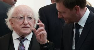 President Michael D Higgins speaks to Saxony's state premier Michael Kretschmer during his visit to the university of Leipzig. Photograph: Peter Endig / dpa / AFP