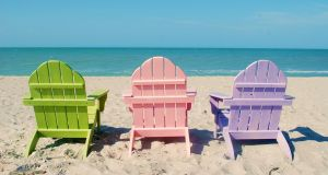 Adirondack chairs in summer tones.  Photograph: Getty