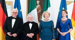 German president Frank-Walter Steinmeier (left) and his wife Elke Buedenbender (right) with President Michael D. Higgins  and his wife Sabina  before a gala dinner in Berlin. Photograph: Hayoung Jeon/EPA