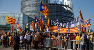 Supporters of Catalan independence protest outside the European Parliament in Strasbourg on Tuesday  at the fact that three elected Catalan MEPs were not allowed to take their seats for its inaugural session. Photograph: Vincent Kessler/Reuters