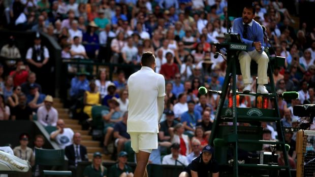 Nick Kyrgios speaks with the match umpire during his defeat to Rafael Nadal. Photograph: Adam Davy/PA