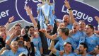 Manchester City manager Pep Guardiola lifts the trophy as they celebrate winning the Premier League. The league has become increasingly concerned at the rise in the number of people in Ireland using free or cheaper illegal web-based sports TV services. File photograph: Toby Melville/Reuters